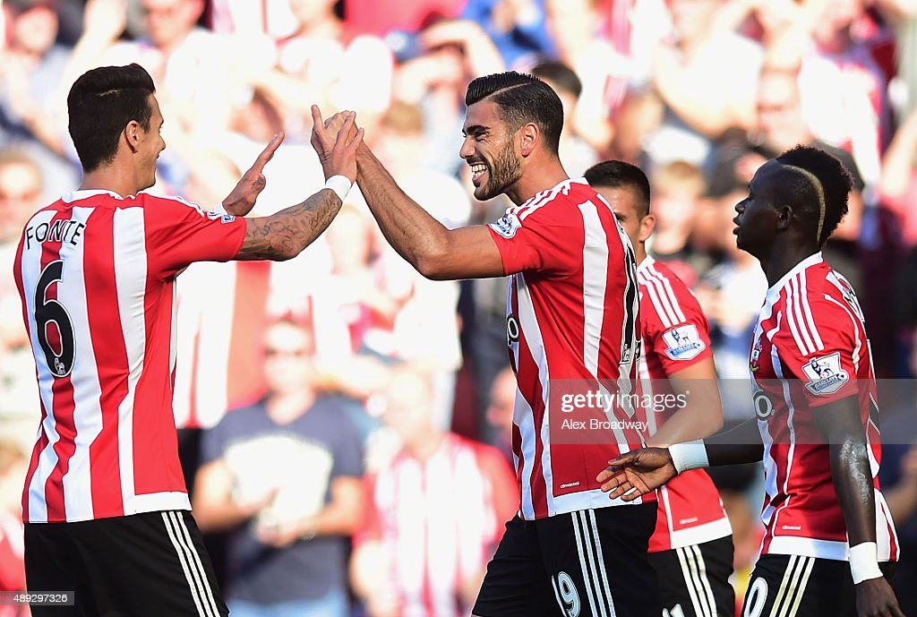 Graziano Pelle of Southampton celebrates with team mates as he scores their first goal during the Barclays Premier League match between Southampton...