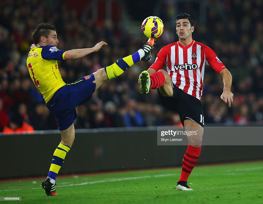 Graziano Pelle of Southampton chalenges Mathieu Debuchy of Arsenal during the Barclays Premier League match between Southampton and Arsenal at St...
