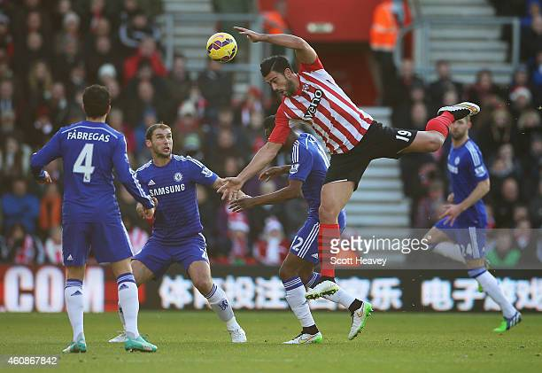 Graziano Pelle of Southampton climbs for a header as Branislav Ivanovic of Chelsea looks on during the Barclays Premier League match between...