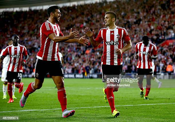 Graziano Pelle of Southampton congratulates Dusan Tadic of Southampton after he scores from a penalty to make it 20 during the UEFA Europa League...