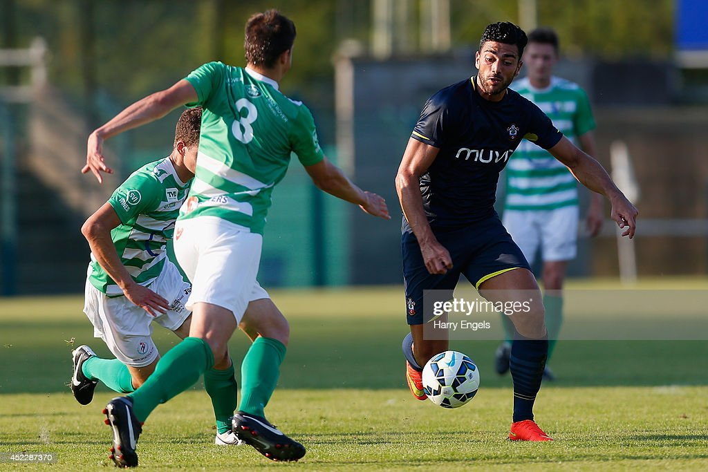 Graziano Pelle of Southampton dives in for a tackle during the pre-season friendly match between KSK Hasselt and Southampton at the Stedelijk Sportstadion on July 17, 2014 in Hasselt, Belgium.