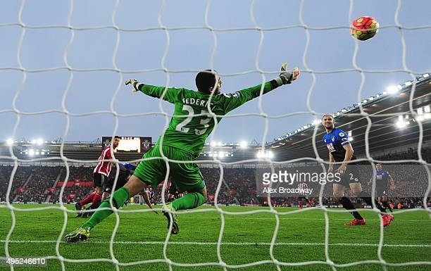 Graziano Pelle of Southampton heads the ball past goalkeper Adam Federici of Bournemouth to score their second goal during the Barclays Premier...