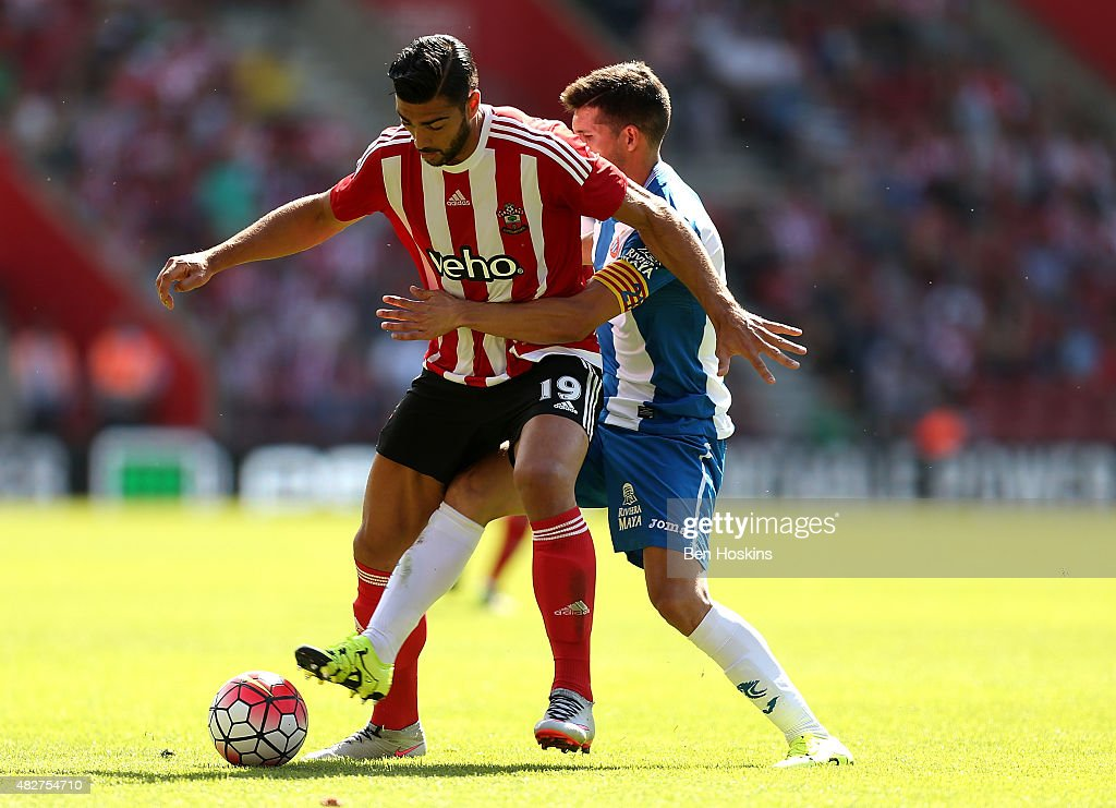 Graziano Pelle of Southampton holds off pressure from Javi Lopez of Espanyol during the pre season friendly match between Southampton and Espanyol at St Mary's Stadium on August 2, 2015 in Southampton, England.