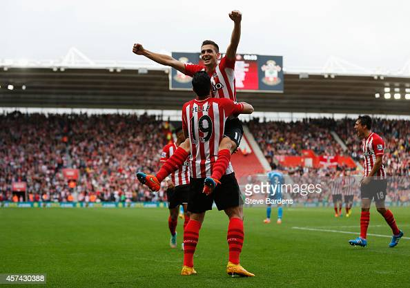 Graziano Pelle of Southampton is congratulated by Dusan Tadic as he scores their fifth goal during the Barclays Premier League match between...