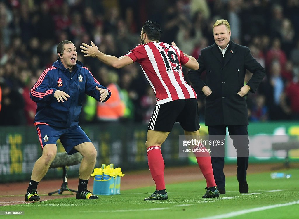 <a gi-track='captionPersonalityLinkClicked' href=/galleries/search?phrase=Graziano+Pelle&family=editorial&specificpeople=2333390 ng-click='$event.stopPropagation()'>Graziano Pelle</a> of Southampton performs a haka style celebration with Southampton sports therapist Graeme Staddon as he scores their second goal as <a gi-track='captionPersonalityLinkClicked' href=/galleries/search?phrase=Ronald+Koeman&family=editorial&specificpeople=652522 ng-click='$event.stopPropagation()'>Ronald Koeman</a> manager of Southampton looks on during the Barclays Premier League match between Southampton and A.F.C. Bournemouth at St Mary's Stadium on November 1, 2015 in Southampton, England.