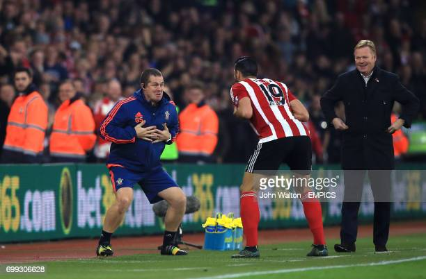 Graziano Pelle of Southampton performs a haka style celebration with Southampton sports therapist Graeme Staddon as Southampton manager Ronald Koeman...