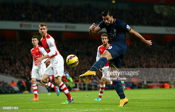 Graziano Pelle of Southampton shoots at goal during the Barclays Premier League match between Arsenal and Southampton at Emirates Stadium on December...