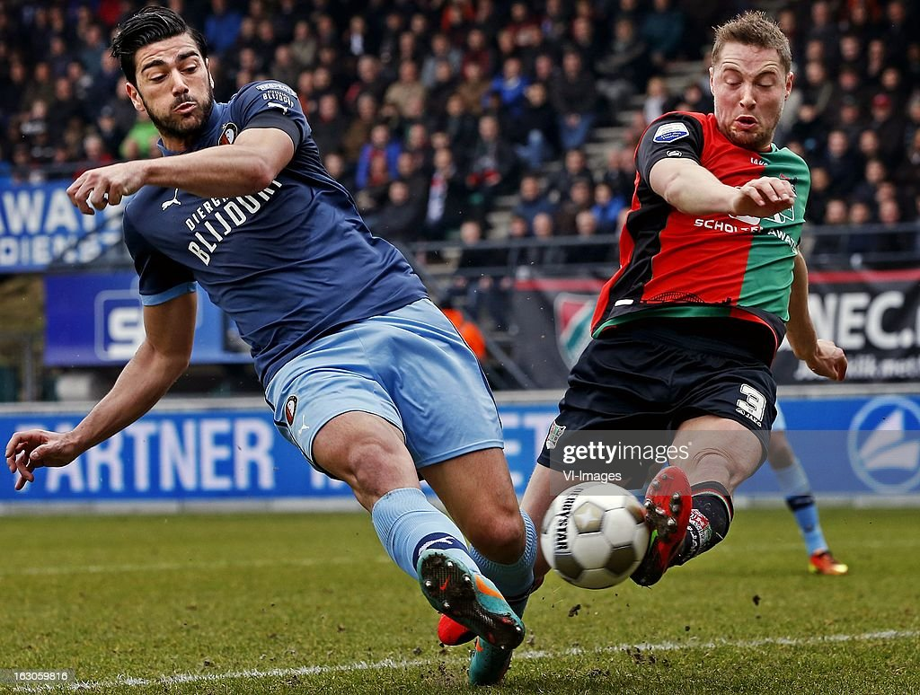 Graziano Pelle (L), Rene van Eijden (R) during the Dutch Eredivisie match between NEC Nijmegen and Feyenoord at the Goffert Stadium on march 03, 2013 in Nijmegen, The Netherlands