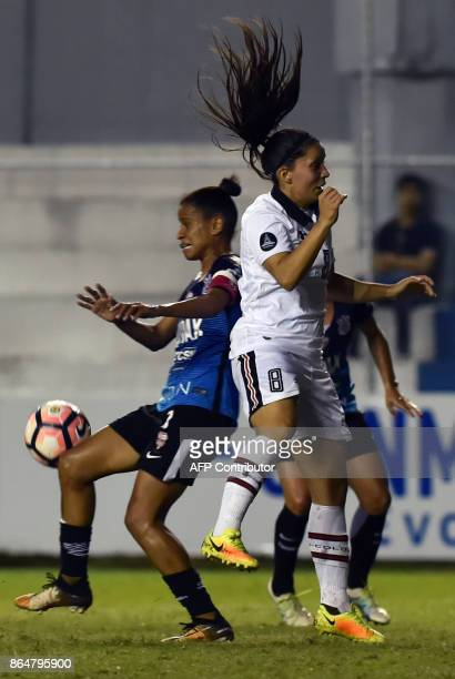 Grazielle Pinheiro of Brazils Audax/Corinthians vies for the ball with Karen Araya of Chile's Colo Colo during the Women Copa Libertadores final...