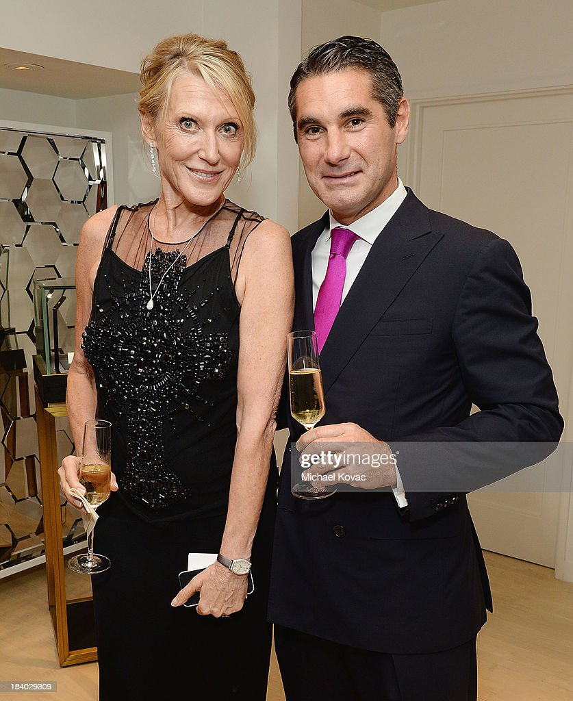Grazka Taylor (L) and Vacheron Constantin North America President, Hugues de Pins, attend the Vacheron Constantin High Jewelry Collection Dinner at a private residence on October 10, 2013 in Los Angeles, California.