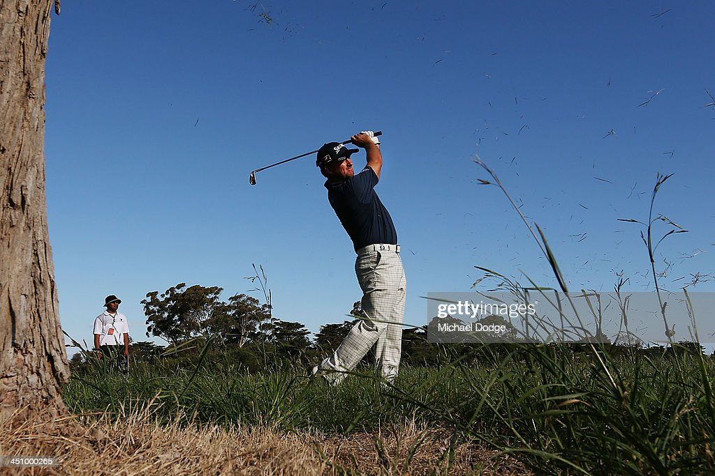 Greame McDowell of Ireland hits an approach shot during day one of the World Cup of Golf at Royal Melbourne Golf Course on November 21, 2013 in Melbourne, Australia.