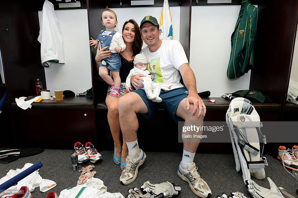 Greame Smith with his family in the changing room during day 5 of the 2nd Test match between South Africa and India at Sahara Stadium Kingsmead on December 30, 2013 in Durban, South Africa.