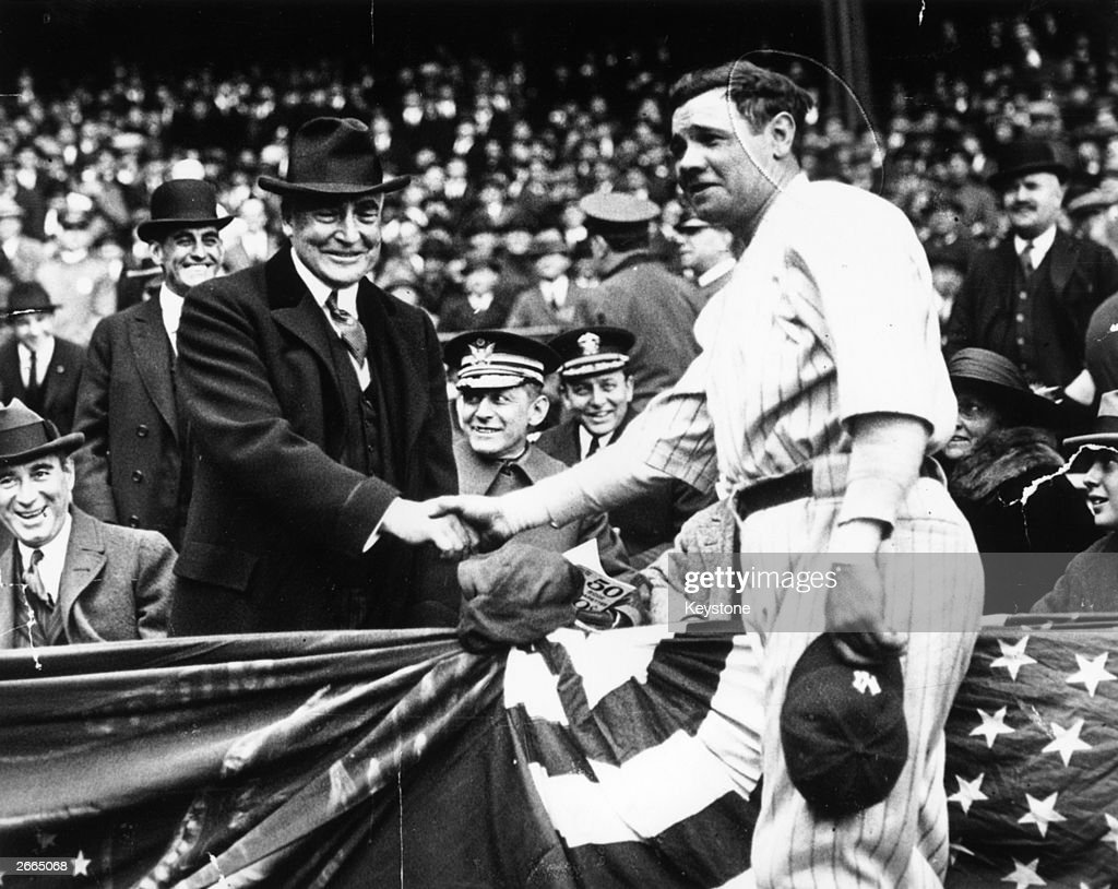 Great all-round baseball player, <a gi-track='captionPersonalityLinkClicked' href=/galleries/search?phrase=Babe+Ruth&family=editorial&specificpeople=94423 ng-click='$event.stopPropagation()'>Babe Ruth</a> (George Herman Ruth, 1895 - 1948) shakes hands with the 29th President of the USA, Warren Harding. After the handshake <a gi-track='captionPersonalityLinkClicked' href=/galleries/search?phrase=Babe+Ruth&family=editorial&specificpeople=94423 ng-click='$event.stopPropagation()'>Babe Ruth</a> hit a home run to help his team, the New York Yankees win the third game of the series with the Wash.