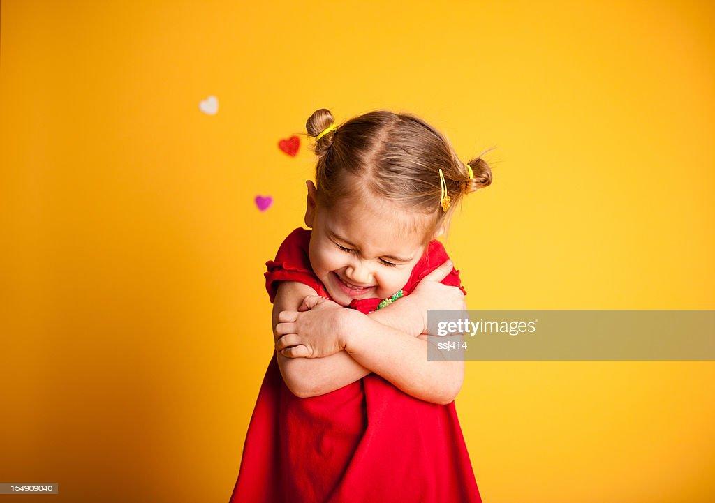 Great Big Valentine Hug, Cute Girl Hugging Herself : Stock Photo