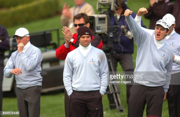 Great Britain and Ireland's Justin Rose Paul Casey captain Nick Faldo and Simon Dyson celebrate as Graeme Storm wins the hole and match at the 18th...