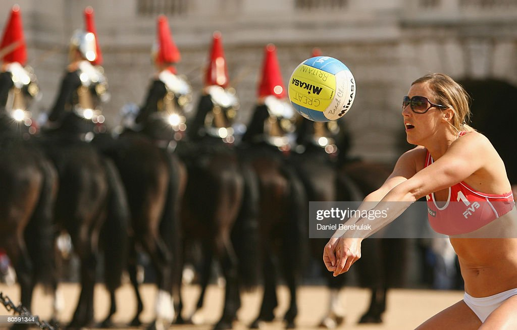 Great Britain Beach Volleyball player Denise Johns digs the ball during a photocall at Horse Guards Parade on April 10, 2008 in London, England. Members of the Household Cavalry Mounted Regiment changed guard whilst Great Britain male and female Volleyball teams practiced in the sports' planned location for the 2012 Olympics.