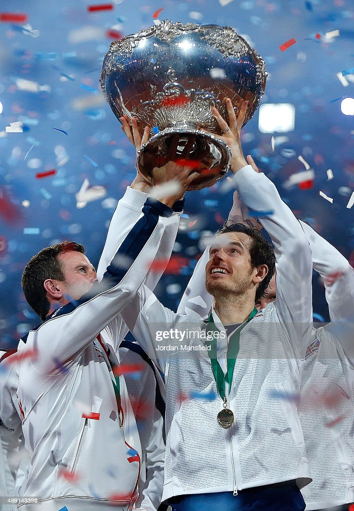 Great Britain Captain Leon Smith lifts the trophy with Andy Murray following their victory during day three of the Davis Cup Final match between...