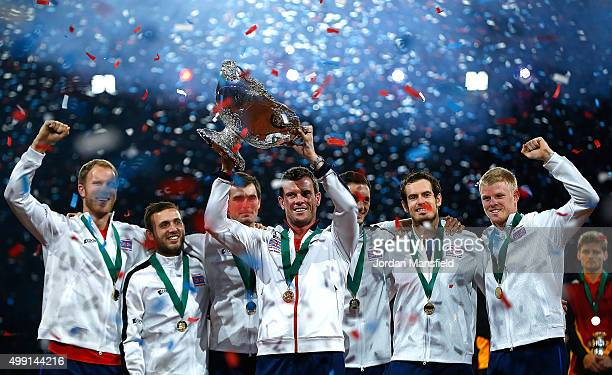 Great Britain Captain Leon Smith lifts the trophy with his players following their victory during day three of the Davis Cup Final match between...