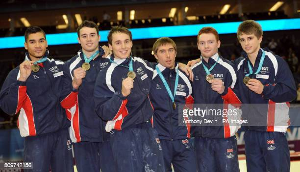 Louis Smith Kristian Thomas Daniel Keatings Ruslan Panteleymonov Daniel Purvis and Max Whitlock celebrate finishing in first place during the Visa...