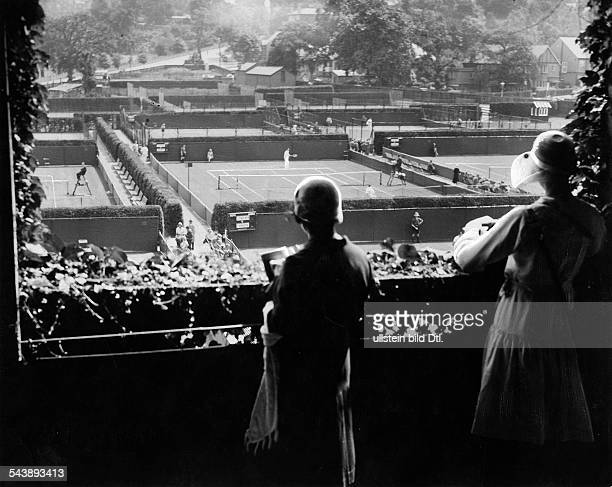 Great Britain England London View over the tennis courts at Wimbledon female spectators in the front Photographer Eduard Schlochauer Published by...