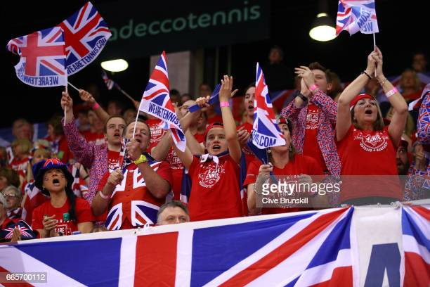 Great Britain fans cheer on Kyle Edmund of Great Britain during the singles match against Lucas Pouille of France on day one of the Davis Cup World...