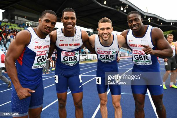 Great Britain Men's 4x100m realy team members Zharmel Hughes Ujah Chijindu Danny Talbot and Harry AikinesAryeetey pose for a picture after winning...