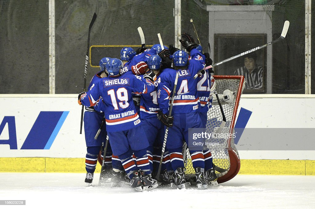 Great Britain players celebrate the win after the Ice Hockey Sochi Olympic Pre-Qualification Group J match between Japan and Great Britain at Nikko Kirifuri Ice Arena on November 11, 2012 in Nikko, tochigi, Japan. Great Britain won 2-1 and went through to the final qualification.
