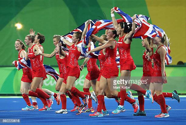 Great Britain players celebrate winning the shoot out against Netherlands to win the Women's Gold Medal Match on Day 14 of the Rio 2016 Olympic Games...