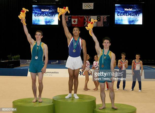 Great Britain Reiss Beckford wins gold in the Floor with Sean O'Hara Silver and Luke Wadsworth both of Australia in the Artistic Gymnastics Apparatus...