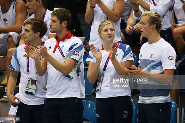 Great Britain swim team members Craig Benson David Davies Rebecca Adlington and Robbie Renwick cheer on their teammates during the evening session on...