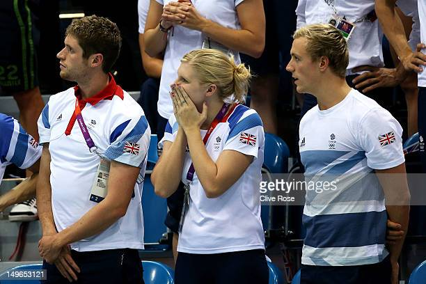 Great Britain swim team members David Davies Rebecca Adlington and Robbie Renwick cheer on their teammates during the evening session on Day 5 of the...