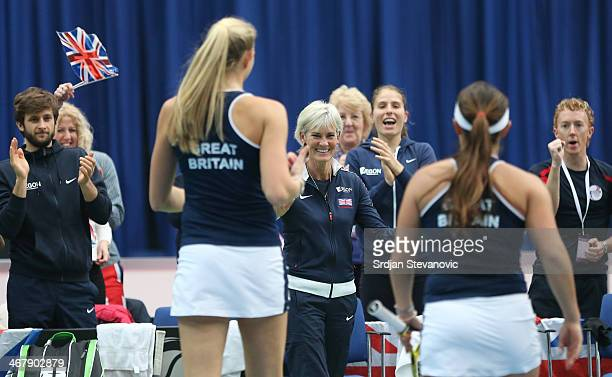 Great Britain team captain Judy Murray and Johanna Konta give their support to Jocelyn Rae and Tara Moore of Great Britain during the match against...
