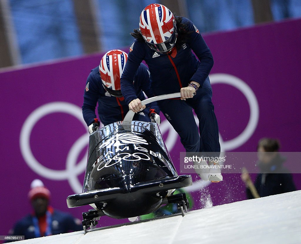 Great Britain-1, two-woman bobsleigh steered by <a gi-track='captionPersonalityLinkClicked' href=/galleries/search?phrase=Paula+Walker+-+Bobsledder&family=editorial&specificpeople=12457486 ng-click='$event.stopPropagation()'>Paula Walker</a>, takes a practice run during a training session at the Sanki Sliding Center in Rosa Khutor during the Sochi Winter Olympics on February 14, 2014. AFP PHOTO / LIONEL BONAVENTURE