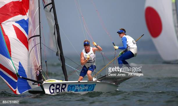 Great Britain's 49er crew Stevie Morrison and Ben Rhodes reset their Spinakker after a gybe during the opening rounds at the 2008 Beijing Olympic...