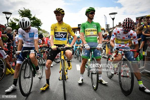 Great Britain's Adam Yate wearing the best young's white jersey Great Britain's Christopher Froome wearing the overall leader's yellow jersey...