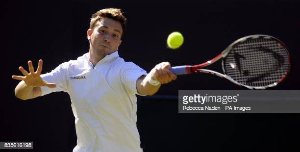 Great Britain's Alex Bogdanovic in action against Czech Republic's Tomas Berdych during the 2009 Wimbledon Championships at the All England Lawn...