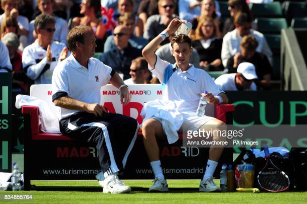 Great Britain's Alex Bogdanovic takes advice from coach John Lloyd during his match against Austria's Jurgen Melzer during the Davis Cup World Group...