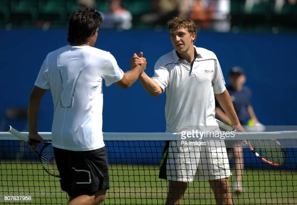 Great Britain's Alexander Ward shakes hands with USA's Taylor Dent after beating him in their second round tie during the AEGON Trophy at Nottingham...
