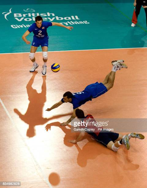 Great Britain's Andrew Pink and Matthew Howe dive for the ball during the FIVB World Championship 2010 First Round match at the English Institute of...