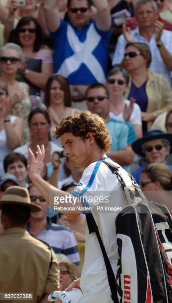 Great Britain's Andy Murray celebrates his win over France's Julien Benneteau during the second round of The All England Lawn Tennis Championships at...