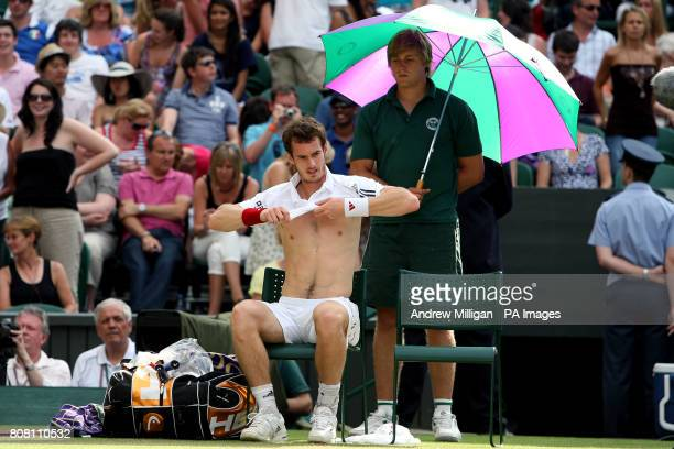 Great Britain's Andy Murray changes his shirt during his match against France's JoWilfried Tsonga