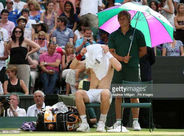 Great Britain's Andy Murray changes his shirt during his match against France's JoWilfried Tsonga during day nine of the 2010 Wimbledon Championships...