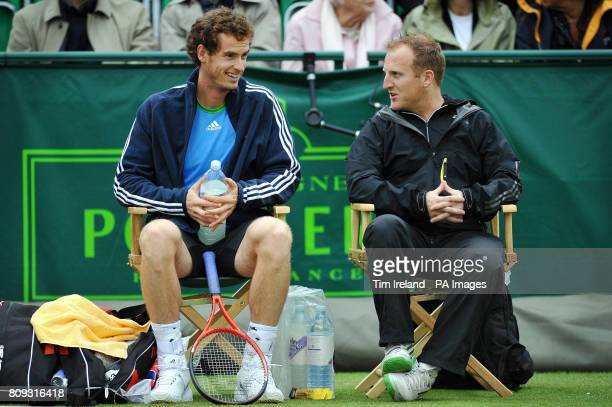 Great Britain's Andy Murray chats with fitness coach Matthew Little during an exhibition match against Serbia's Victor Troicki during The Boodles...