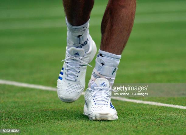 Great Britain's Andy Murray has his ankles in ankle supports during an exhibition match against Serbia's Victor Troicki during The Boodles event at...