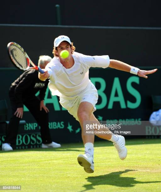 Great Britain's Andy Murray in action against Austria's Jurgen Melzer during the Davis Cup World Group PlayOffs at The All England Lawn Tennis Club...