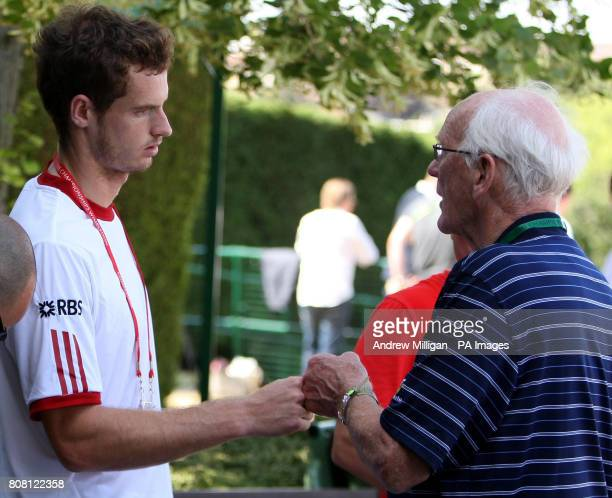 Great Britain's Andy Murray meets his grandfather Roy Erskine following a practice session during Day Eight of the 2010 Wimbledon Championships at...
