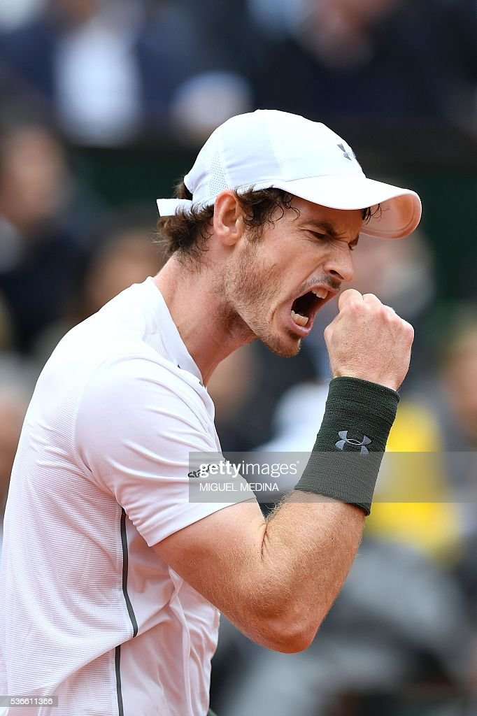 Great Britain's <a gi-track='captionPersonalityLinkClicked' href=/galleries/search?phrase=Andy+Murray+-+Tennis+Player&family=editorial&specificpeople=200668 ng-click='$event.stopPropagation()'>Andy Murray</a> reacts after winning a point during his men's quarter-final match against France's Richard Gasquet at the Roland Garros 2016 French Tennis Open in Paris on June 1, 2016. / AFP / MIGUEL