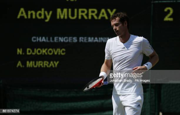 Great Britain's Andy Murray reacts in his Men's Final against Serbia's Novak Djokovic during day thirteen of the Wimbledon Championships at The All...