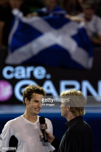 Great Britain's Andy Murray speaks to Jim Courier after defeating Spain's Marcel Granollers during the Australian Open 2009 at Melbourne Park...