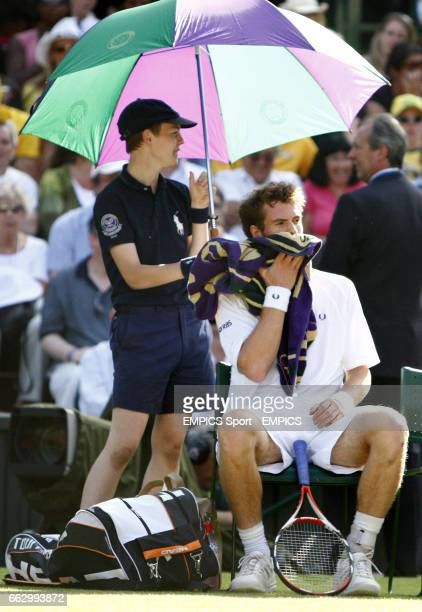 Great Britain's Andy Murray takes a break during his match against France's Richard Gasquet